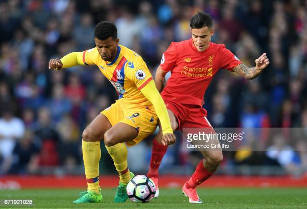 Fraizer Campbell of Crystal Palace and Philippe Coutinho of Liverpool compete for the ball during the Premier League match between Liverpool and...