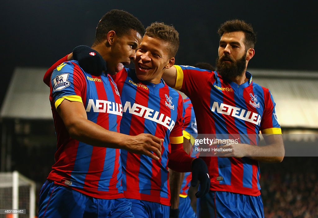 Fraizer Campbell of Crystal Palace (L) celebrates scoring their first goal with Dwight Gayle and Joe Ledley of Crystal Palace during the Barclays Premier League match between Crystal Palace and Newcastle United at Selhurst Park on February 11, 2015 in London, England.