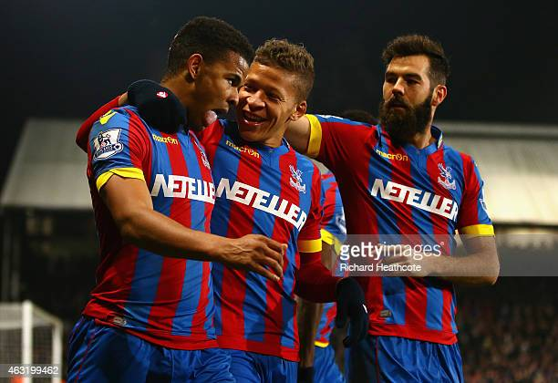 Fraizer Campbell of Crystal Palace celebrates scoring their first goal with Dwight Gayle and Joe Ledley of Crystal Palace during the Barclays Premier...