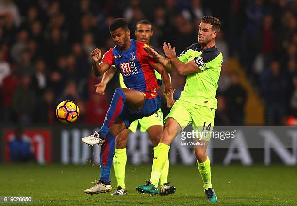 Fraizer Campbell of Crystal Palace holds off pressure from Jordan Henderson of Liverpool during the Premier League match between Crystal Palace and...