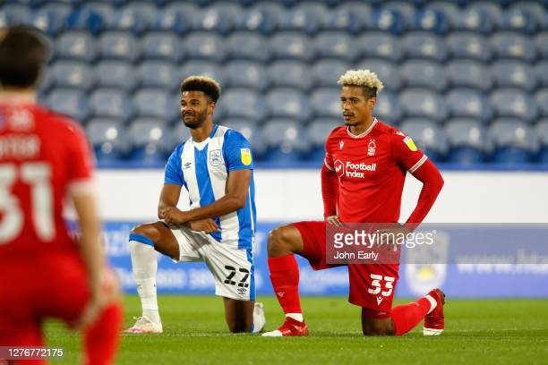 Fraizer Campbell of Huddersfield Town and Lyle Taylor of Nottingham Forest Take the knee during the Sky Bet Championship match between Huddersfield...