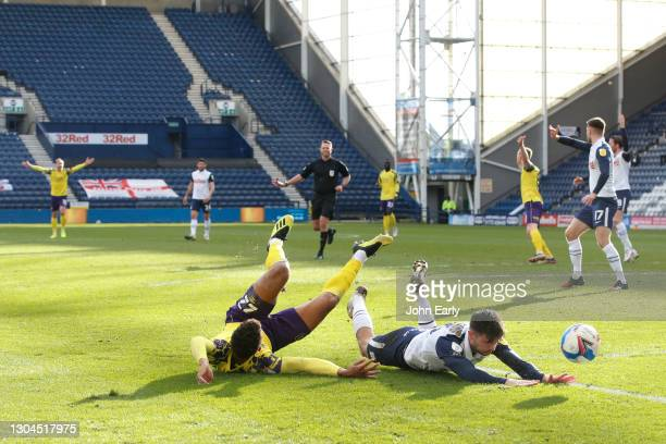 Fraizer Campbell of Huddersfield Town appears to be brought down inside the penalty area during the Sky Bet Championship match between Preston North...