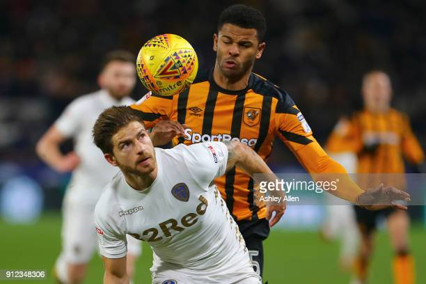 Fraizer Campbell of Hull City is held off by Gaetano Berardi of Leeds United during the Sky Bet Championship match between Hull City and Leeds United...