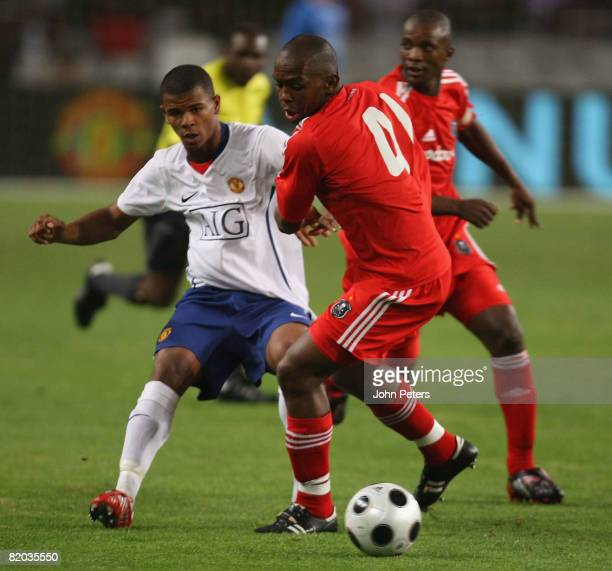 Fraizer Campbell of Manchester United clashes with Bennet Chenene of Orlando Pirates during the Vodacom Challenge preseason friendly match between...