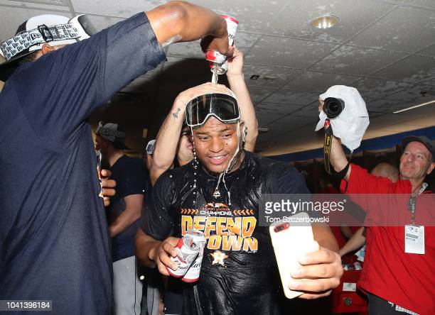 Framber Valdez of the Houston Astros celebrates in the clubhouse after the Astros clinched the American League West division title after their MLB...
