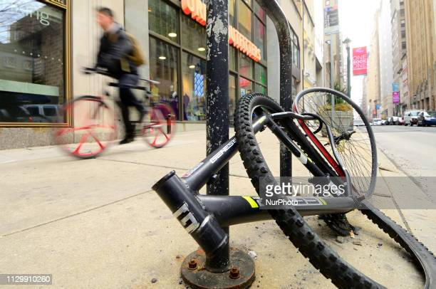 Frame and parts of the wheels remain locked on the street while the rest of what was once a bicycle were taken in center City Philadelphia PA on...