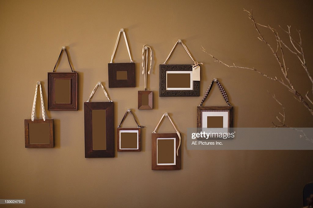 Frame Cluster On Brown Wall Stock Photo | Getty Images