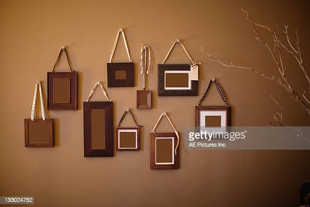 Frame cluster on brown wall