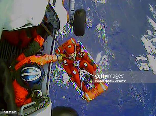 A frame from a video shows a crew member of the HMS Bounty being lifted to a Coast Guard rescue helicopter in a rescue basket Monday October 29 90...