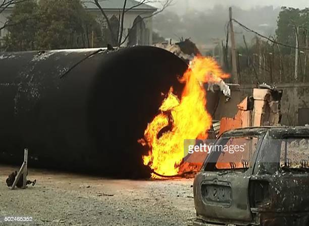 A frame grab made on December 25 2015 from a video shot the same day by TV Continental shows a burning cistern and a burnt car in the aftermath of a...