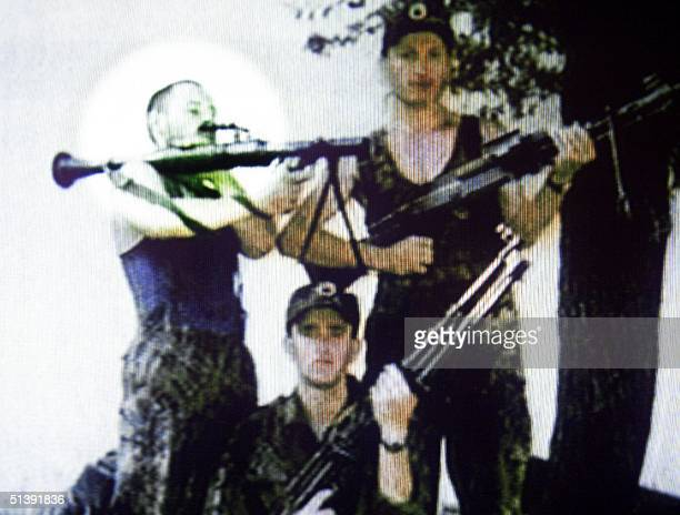 TV frame grab of an undated photo taken in Kosovo shows Australian David Hicks who has been captured with Osama bin Laden's alQaeda troops near...
