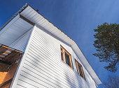 frame house and white siding