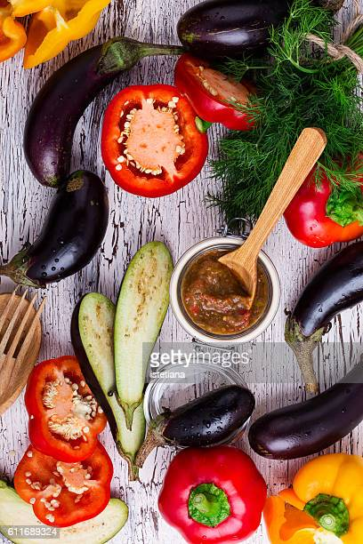 Frame of autumn organic vegetables to prepare dishes of eggplant on white wooden table  top view