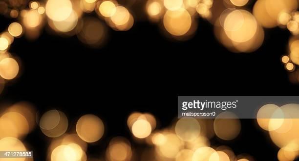 Frame of defocused lights on black with copyspace
