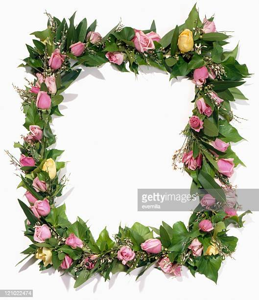 frame of flowers cut out on white