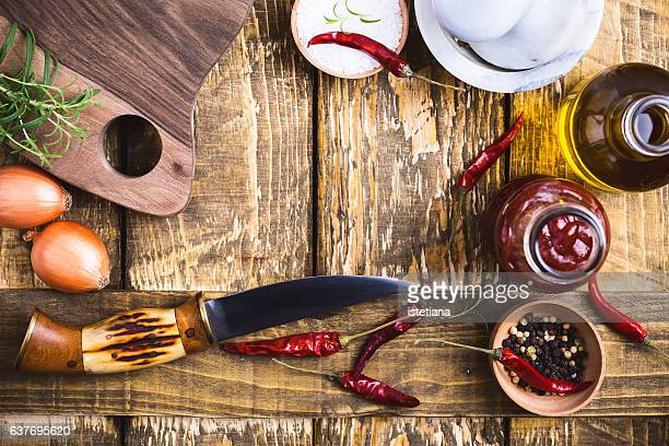 frame of herbs and spices. top view of cooking ingredients with copy space - barbeque sauce stock photos and pictures