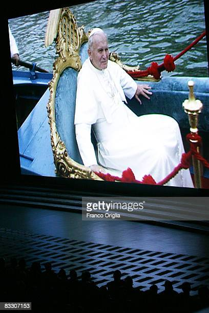 Frame of John Paul II is displayed during a screening at the Paul VI Hall on the 30th anniversary of the John Paul II 's election as a pontiff,...