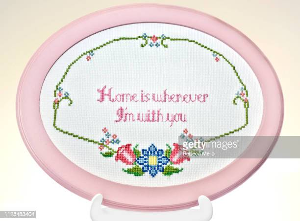 frame with romantic embroidery - embroidery stock pictures, royalty-free photos & images