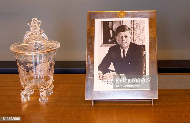 A framed and signed picture of former US President John F Kennedy that was presented to Britain's Queen Elizabeth II is pictured during a photocall...