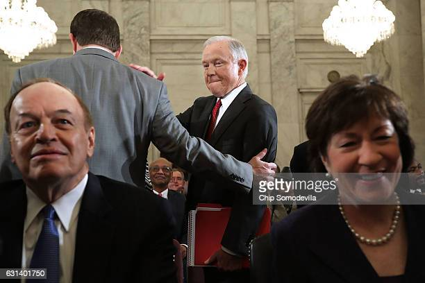 Framed by Sen Richard Shelby and Sen Susan Collins Sen Jeff Sessions prepares for his confirmation hearing to be the US attorney general before the...