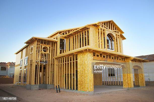 framed house under construction - construction frame stock pictures, royalty-free photos & images