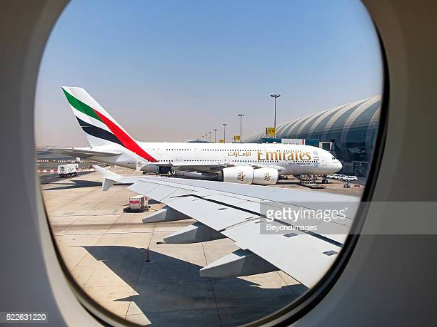 framed in the window, emirates a380 in dubai - emirates airline stock photos and pictures
