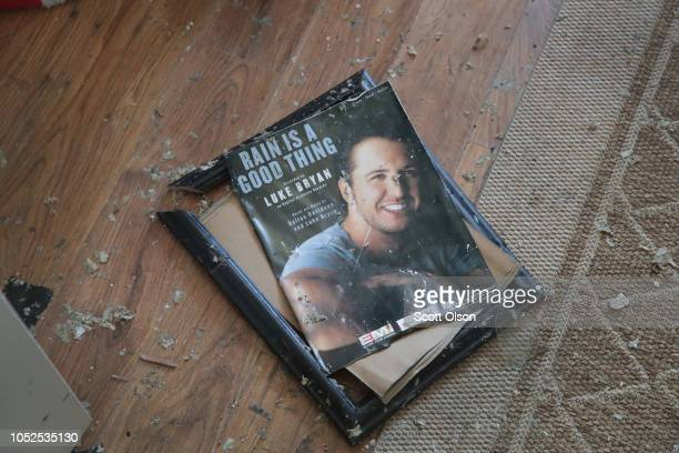 A framed momento from her son's music career lays broken on the floor of the home of LeClaire Bryan mother of country music artist Luke Bryan after...