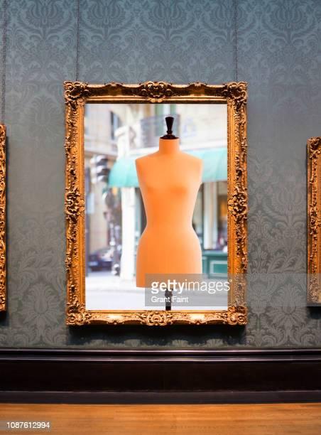 framed photograph hanging on wall. - paris fashion week fotografías e imágenes de stock