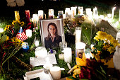 Framed photograph of gabrielle giffords stands amongst candles at a picture id107942459?s=170x170