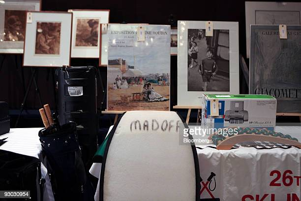 Framed photos and a boogie board are amoung lotts displayed during a media preview for an auction which includes jewelry and other personal items...