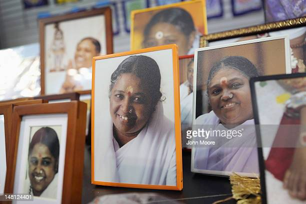 Framed photos of Mata Amritanandamayi also known as 'The Hugging Saint' sit on a display to be sold on July 10 2012 at Javits Center in New York City...
