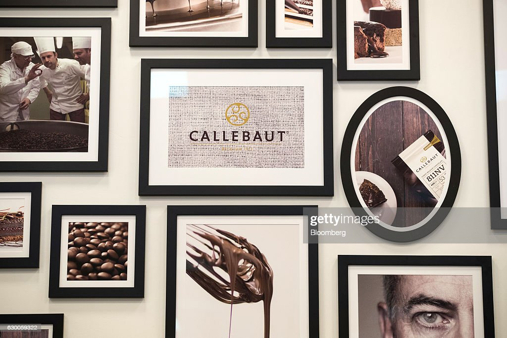 Framed pictures of chocolate making hang on the wall inside the Barry Callebaut AG Institute in Wieze, Belgium, on Wednesday, Dec. 16, 2016. The 3-D printing process can cut down the time and effort in crafting desired products, while expanding design possibilities that may be too intricate for human hands. Photographer: Jasper Juinen/Bloomberg via Getty Images