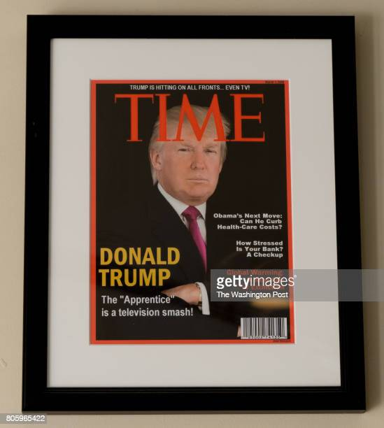 Framed portrait of President Donald Trump on the cover of a TIME Magazine and other magazine covers framed and hanging from a wall at the Trump...