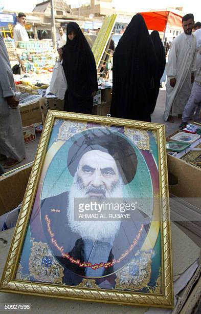 A framed portrait of top Shiite Muslim Grand Ayatollah Ali Sistani is on sales in a market in the holy city of Najaf some 120 kms south of Baghdad 05...