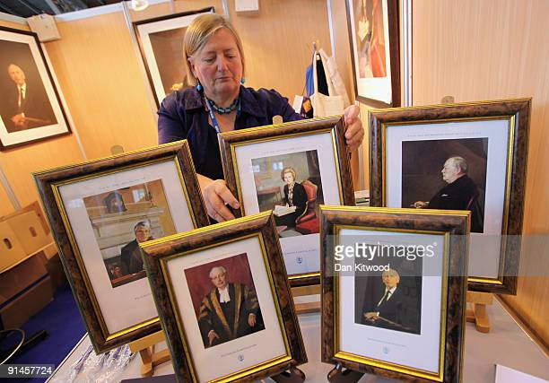 Framed portraits of former Conservative Prime Ministers are displayed on The Carlton Club trade stand in the exhibition hall during the Conservative...