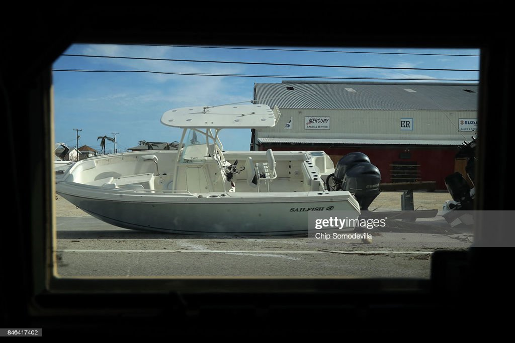 Framed through a Florida Army National Guard Humvee window, a boat sits on the side of the highway on Big Pine Key two days after Hurricane Irma slammed into the state, on September 12, 2017 in Marathon, Florida. The Federal Emergency Managment Agency has reported that 25-percent of all homes in the Florida Keys were destroyed and 65-percent sustained major damage when they took a direct hit from Hurricane Irma.