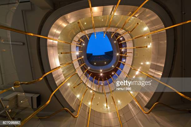 framed view of the unicredit tower entrance in piazza gae aulenti, milan-italy - striato stock pictures, royalty-free photos & images