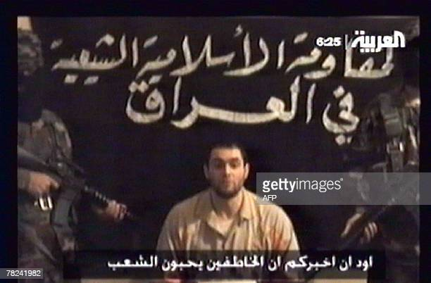 A framegrab from a video broadcast 03 December 2007 by the Dubaibased panArab AlArabiya news channel shows an alleged hostage flanked by two masked...