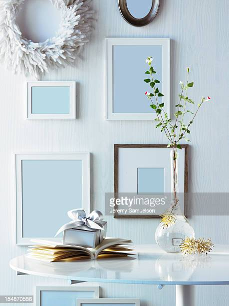 Frames on Wall with Present on Table
