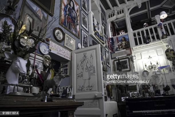 Frames plates statues and various objects adorn the walls of the late French writer Gonzague SaintBris' flat in Paris on January 22 2018 / AFP PHOTO...