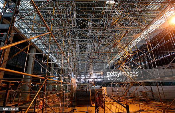 Framework of metal scaffolding is seen in the main area of the new Berlin-Brandenburg International Airport in Berlin, Germany, on Friday, March 9,...