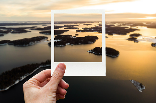 Framing the aerial view of Stockholm archipelago with polaroid picture from personal perspective. - gettyimageskorea