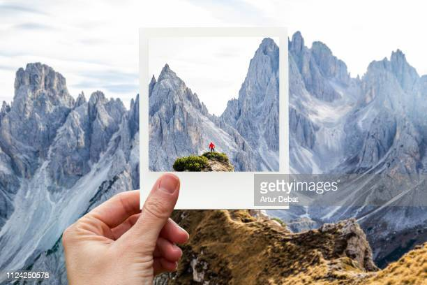 framing the italian alps dolomites with polaroid picture from personal perspective. - alto adige italy stock pictures, royalty-free photos & images