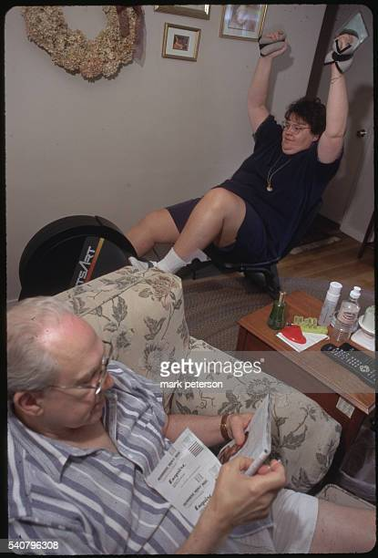 Framingham Massachusetts Frank DeSaulnier and his wife Faye working out at home Faye is an offspring