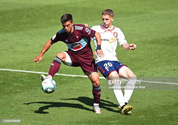 Fran Beltran of Celta Vigo and Darko Brasanac of Osasuna battle for the ball during the Liga match between CA Osasuna and RC Celta de Vigo at on July...
