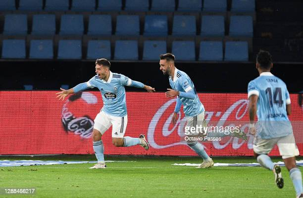 Fran Beltran of Celta Vigo celebrates with team mate Brais Mendez after scoring their sides third goal during the La Liga Santander match between RC...