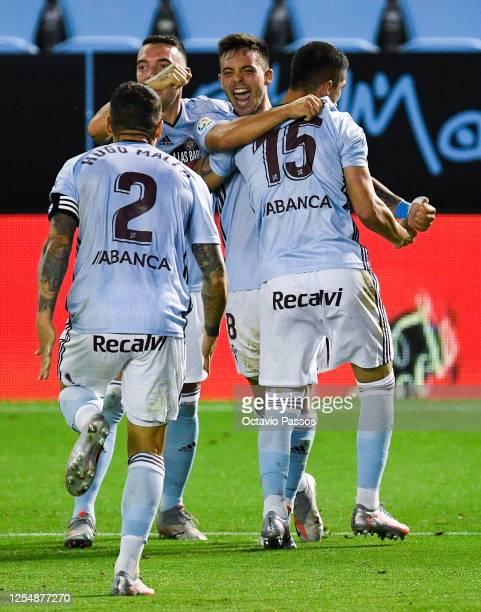 Fran Beltran of RC Celta de Vigo celebrates with his team mates after scoring his team's first goalduring the Liga match between RC Celta de Vigo and...