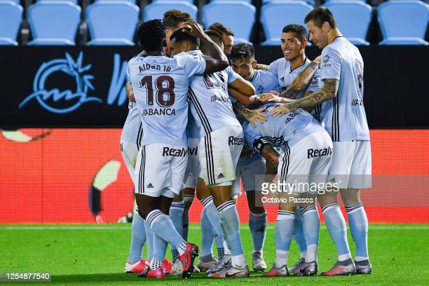 Fran Beltran of RC Celta de Vigo celebrates with his team mates after scoring his team's first goalduring the Liga match between RC Celta de Vigo and...