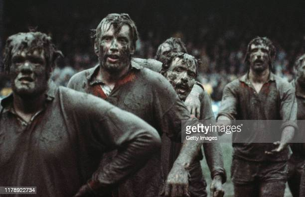 Fran Cotton in the foreground of a mud covered British Lions lineout along with Moss Keane Phil Orr and Jeff Squire against New Zealand Juniors who...