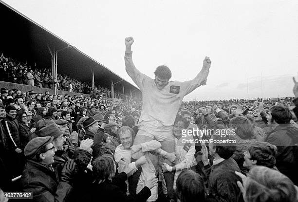 Fran Cotton is carried from the field as the North West Counties celebrate a famous victory over the New Zealand All Blacks 1614 at Ellis Sports...